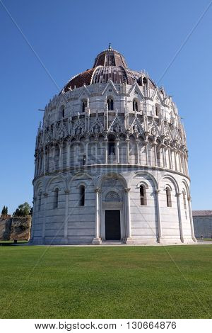 PISA, ITALY - JUNE 06, 2015: Baptistery of St. John, Cathedral St. Mary of the Assumption in the Piazza dei Miracoli in Pisa, Italy. Unesco World Heritage Site, on June 06, 2015