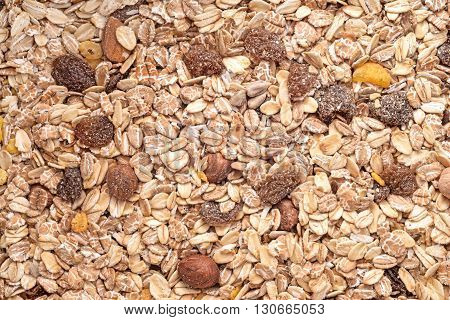 raisins nuts mix with oat cereals background