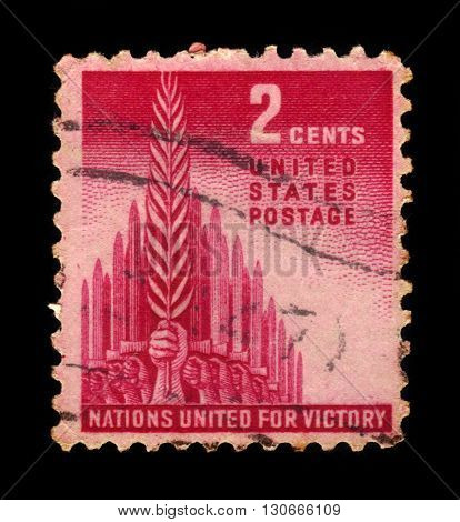 USA - CIRCA 1943: a stamp printed in USA shows Allegory of Victory, hands holding swords and olive branch, circa 1943;