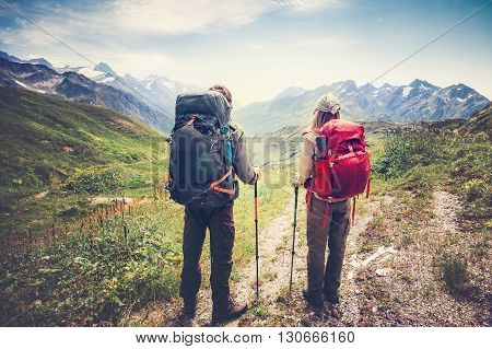 Couple Man and Woman Travelers backpackers mountaineering Travel Lifestyle and relationship love concept mountains landscape on background
