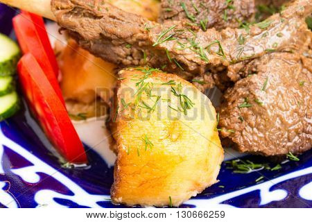 Delicious baked lamb racks with vegetable garnish and minced dill. Macro. Photo can be used as a whole background.