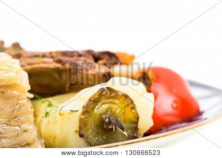 Delicious baked lamb meat wit stewed vegetable mix as a carrot and cabbage in eastern style. Macro. Photo can be used as a whole background.