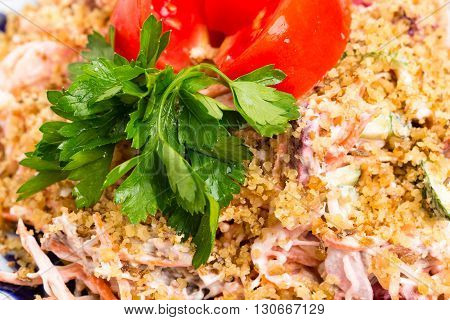 Delicious veal salad with fresh vegetables and covered with grated walnuts. MAcro. Photo can be used as a whole background.