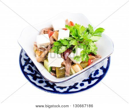 Delicious salad with veal tongue and champignons. Isolated on a white background.