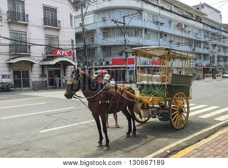 Manila Philippines - July 19 2015 : A Kalesa (or Horse Carriage) in Historic Town of Intramuros Intramuros is the oldest district and historic core of Manila Philippines