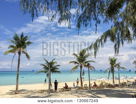 Boracay Philippines - July 21 2015 : People relaxing on the beach with blue sky on Boracay island