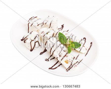 Oriental delicious nougat dessert covered with chocolate and coconut. Isolated on a white background.