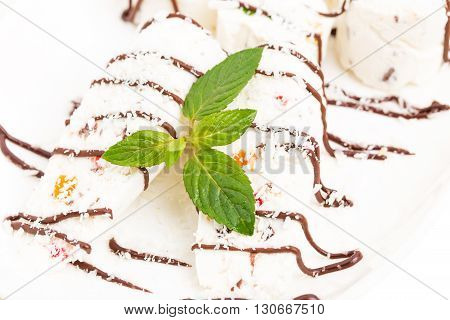 Oriental delicious nougat dessert covered with chocolate and coconut. Macro. Photo can be used as a whole background.