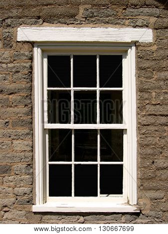 a picture of an exterior 1860's era adobe ranch house window
