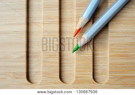 two Color pencil composition on wooden background