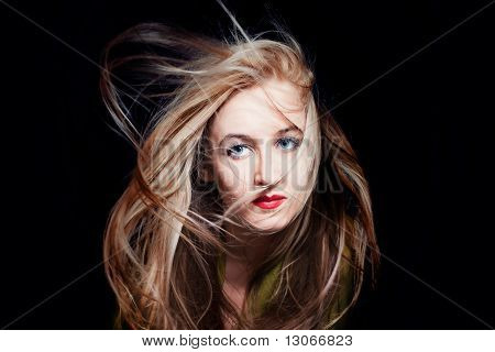 Woman With Hair Fluttering In Wind