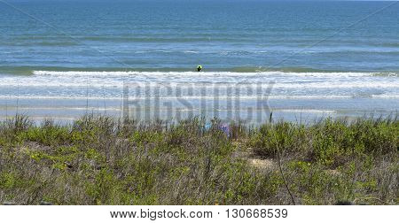 lone surfer on the beach at St. Augustine, Florida