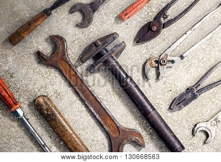 Grungy and rusty old hand tools .Useful as background for repairs.