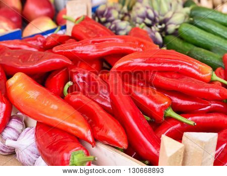Fruit market with various fruits and vegetables. Fresh vegetables and fruits at a market stall. Colorful vegetable and fruits in a row with copy space. Pointed pepper in the foreground.