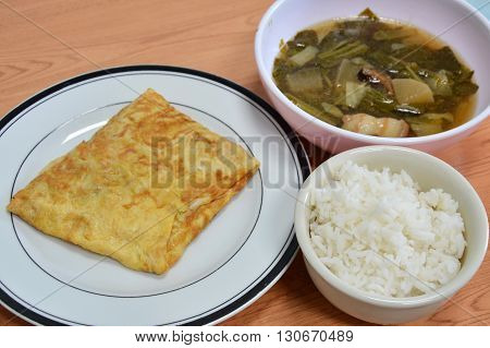 stuffed omelets with Chinese vegetable stew to eat with rice