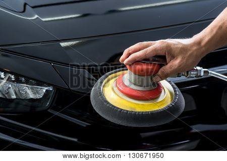Car detailing series : Closeup of hand polishing black car