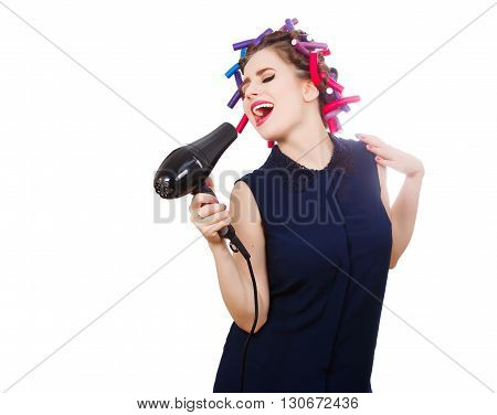 Female vocalist in curler uses hairdryer like microphone. Isolated