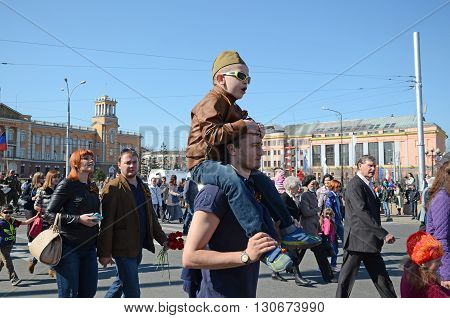 Irkutsk, Russia - May 9, 2015: Young Boy On Fathers Shoulders On Victory Day Procession In Irkutsk