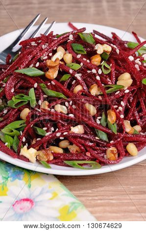 of fresh grated beets onions flavored with nuts and sesame seeds