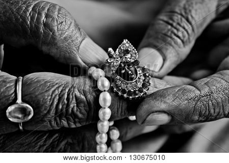 Wrinkled fingers grandmother kept luxury jewelry ring