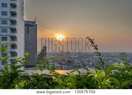 Cityscape: Sunset and the city view of low rises buildings in Bangkok Thailand