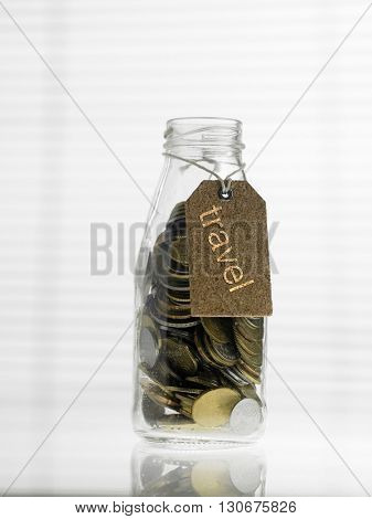 Concept image of personal finance, saving, investment. Coins in Glass jar with