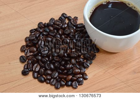 black coffee cup and bean on table