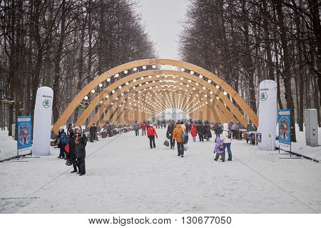 MOSCOW, RUSSIA - JAN 9, 2015: People walk at alley in Sokolniki park during New Year and Christmas holidays.