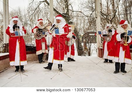 MOSCOW, RUSSIA - JAN 9, 2015: Santa Claus band performs on open air ground in Sokolniki park during New Year and Christmas holidays.
