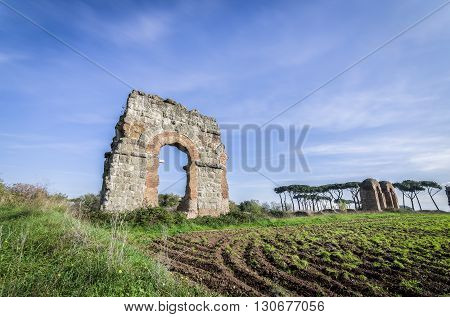 Italy, Rome, Acquedotto Claudio - Old ruins and nature at the Aqueducts Park