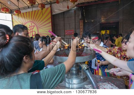 Thai People Pray In Chinese Temple