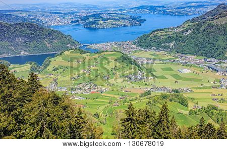 View from the open deck of a cable car gondola heading from Mt. Stanserhorn towards the town of Stans in Switzerland. Town of Stans is the capitall of the Swiss canton of Nidwalden.