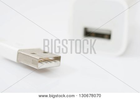 Usb White Charger Adapter And Usb Cable On White Background