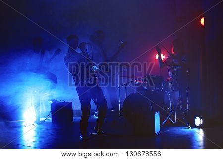 Music band performing on stage.