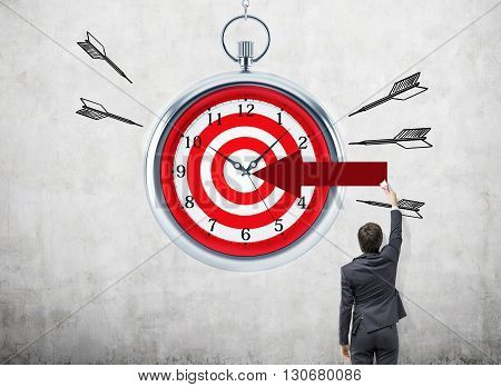 Time management and targeting concept with businessman
