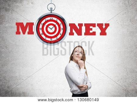 Time management and targeting concept with thoughtful businesswoman