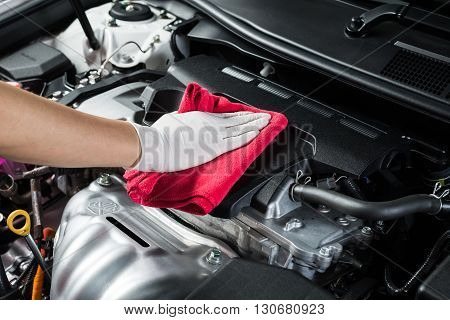 Car detailing series : Closeup of hand cleaning car engine