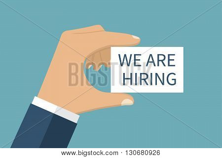 WE ARE HIRING vector. Card with text in hands. Message on the card WE ARE HIRING in hands of businessman. Isolation on background. Vector illustration flat design style. Template.