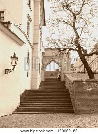 Beautiful nook in Brno, Czech Republic with stairs leading up the old street in ochre tones