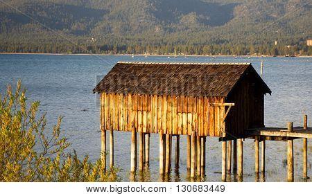 Boat house on Alpine Lake overlooking mountains