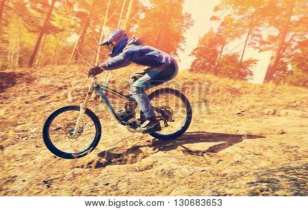 man riding a mountain bike outdoor. extreme sport