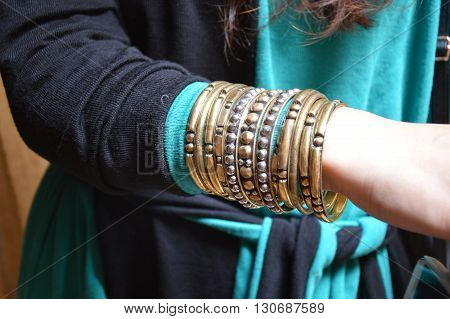 lady wearing copper colored bangles ethnic indian