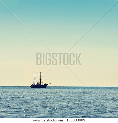 sailing ship the high seas on the horizon in good weather on a background of blue sky. marine background. marine tourism