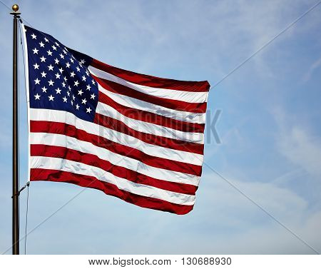 Flag Usa Fluttering In Wind On Blue Sky And Clouds