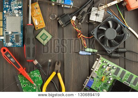 Table electronics repairman. Home computer repair. Desktop clutter electronics repairman. Recycling of multiple computers. Sales of electronic parts.