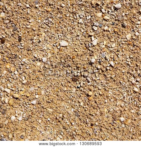 Sand and stone pebbles. Summer beach background