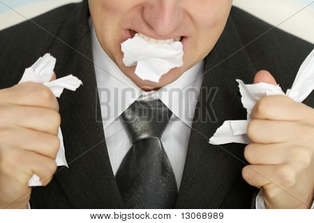 Businessman Furiously Tearing Paper