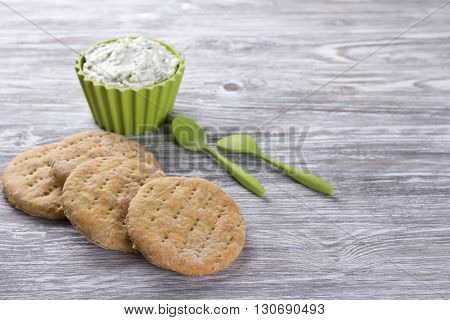 Homemade oat wheat flat bread with dip sauce on wooden table