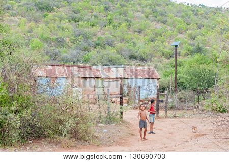 BAVIAANSKLOOF SOUTH AFRICA - MARCH 6 2016: Unidentified children in front of their house in the Baviaanskloof (baboon valley). The house is fitted with solar power