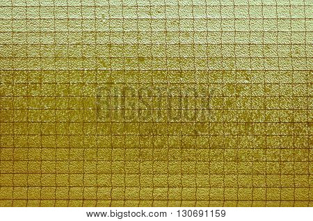 Old light yellowish-brown glass vintage background textured